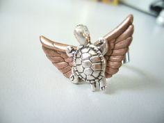 A turtle with wings ring via Etsy.