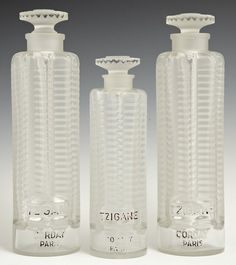 Lot:Three Lalique Art Deco Crystal Perfume Bottles, 1937, Lot Number:868, Starting Bid:$150, Auctioneer:Crescent City Auction Gallery, Auction:Three Lalique Art Deco Crystal Perfume Bottles, 1937, Date:05:00 AM PT - Sep 21st, 2014