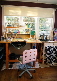 The window is wonderful, great light for working. Also like the fabric hanging over storage bins to keep dust out and the studio area cleaner.