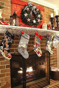 2013 Christmas Fireplace decor, Christmas colorful stockings, green garland, Christmas Fireplace Decor Ideas #Christmas #Fireplace #decor www.loveitsomuch.com