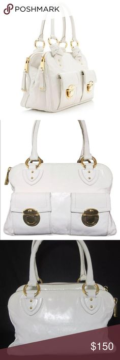 Marc Jacobs Marc jacobs handbag in white handbag with three pockets divided inside and smaller pockets. This purse is organized and perfect for a girl who looses track of the items inside her bag. This purse features gold hardware and white Italian leather with lined interior. In great condition with some normal wear to leather and hardware. Interior in excellent condition with no visible signs of use. White Italian leather with gold hardware. Marc Jacobs Bags Shoulder Bags