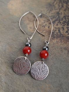 Handmade sterling silver embossed earrings with carnelian by ARC Jewellery.