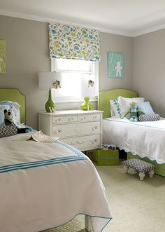 girl's rooms - gray walls green lamps green headboards twin beds white hotel bedding blue stitching white black geometric bolster pillows stool white shabby chic vintage chest green rug turquoise blue pillows green blue gray roman shade