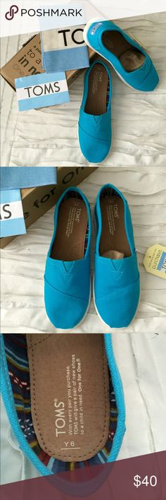 Classic TOMS electric blue loafers Great for the summer and super comfortable Classic TOMS electric blue loafers. Size 6 youth which means is size 8 in women's. New in box. Color no longer available. Absolute Lowest price! TOMS Shoes Flats & Loafers