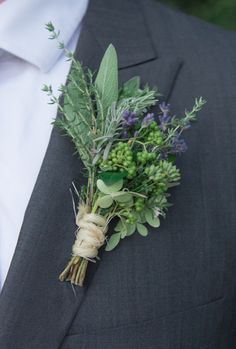 English lavender, rosemary, beauty berries, garden sage and Annabelle hydrangeas come together in floral design