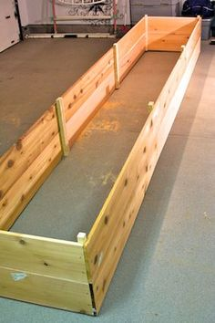 How To:  Raised Garden Bed Series.  Drill holes in the front for drainage and make a solid bottom so it can go along the house