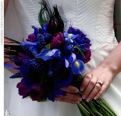 ... it consists of purple dendrobium orchids, purple tulips, lisianthus, grape hyacinths, irises, dark blue viburnum tinus berries, and peacock feathers.