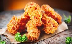 Buy Crispy fried kentucky chicken wings on wooden table by Subbotina on PhotoDune. Crispy fried kentucky chicken wings on wooden table Cooking Fried Chicken, Perfect Fried Chicken, Healthy Fried Chicken, Low Carb Chicken Recipes, Creamy Chicken, Keto Chicken, Shrimp Recipes, Salmon Recipes, Crockpot Recipes