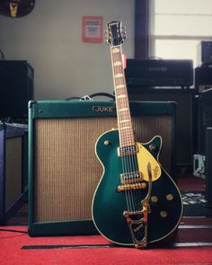 Here's some glorious green guitar goodness. This Gretsch G6128TGC Duo Jet from 2016 has a very cool throwback look similar to a 50's Duo Jet. Pair it with the Juke Warbler 1210 and you've got all the vibe. See more of these green machines at elderly.com.