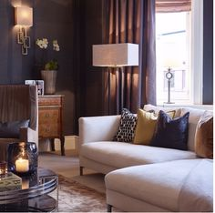 How to mixed different styles in one room.  Elegant living room with pale sofa against dark walls. www.in-form-design.com