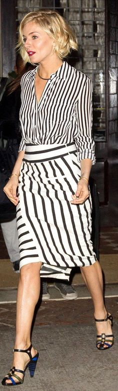 Sienna Miller in a lined Altuzarra bodysuit and a matching blanket stripe skirt, styling the two with a Jennifer Fisher choker and black Sonia Rykiel sandals.