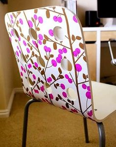 Decoupage Chair  Chair Back Are your plain chairs in need of an upgrade? Look no further than an eye-catching print from some graphic wrapping paper—the options are endless and the price can't be beat. You could also use leftover wallpaper for an extra coordinated look.