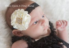 This stunning shabby chic flower headband is the piece you wont want to live without. Simple, yet elegant, it features an ivory satin flower on a black lace elastic headband. It is topped off with an eye catching gold rhinestone cluster center. Simply amazing.    ** Perfect newborn, infant, or toddler photo prop **    Check out my shop for other great headbands and accessories! Great for photo props, gifts, special occasions, etc. These headbands can be made to fit newborns through adults…