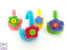 These Little Egg Baskets are a fun project that can hold a single egg or perhaps a treat. An easy to crochet basket is finished with a beautiful one round flower and a cheery button center. Little Eg
