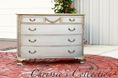 This pretty dresser was finished in Modern Masters Silver with the details in Gold Rush. We added an antiqued finish using a mix of glazes. I love that it is bold and neutral at the same time. Perfect for adding a little pizazz in any room! Sharing at Be Different...Act Normal Thanks for