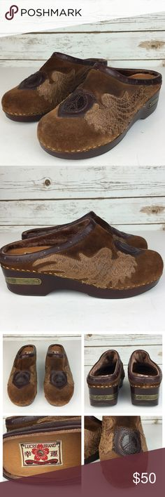 "[Lucky] Fable Suede Leather Clogs Mules Boho Peace Unique pair of Lucky Brand mules. Suede with leather appliqué of wings, heart, and peace sign. Wedge heel has brass logo plate. River trim. Lightly padded footbed.   Heel Height: 1.5"" Condition: Excellent condition. No flaws. Very little signs of wear. Lucky Brand Shoes Mules & Clogs"