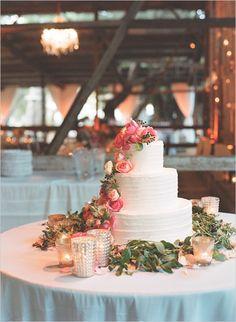 white wedding cake with pink floral accents #weddingcake #whiteweddingcake #weddingchicks http://www.weddingchicks.com/2014/02/05/dos-pueblos-ranch-wedding-2/