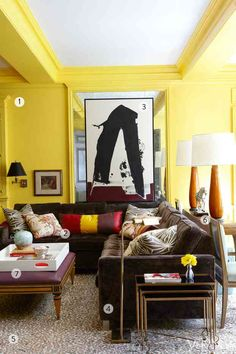 Ideas on working with yellow walls. Also, that multi-paned antique mirror could be a good DIY candidate for the mantle bump out. The artwork layered on top is a nice touch too.