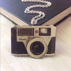 "Vintage camera necklace➳Photographer jewelry This cute vintage camera pendant is made from laser cut wood. The perfect accessory for someone who is into photography! Necklace chain is 18"". If you need a different length, let me know what you prefer. Nickel & lead free! Handmade/brand new. Bundle & save 15% on 3+ items Abbie's Anchor Jewelry Necklaces"