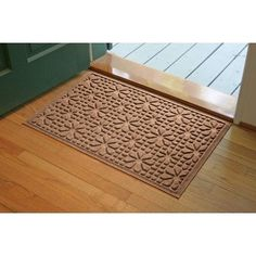 Aqua Shield Stained Glass Mat Size: 2' x 3', Color: Dark Brown by Bungalow. $34.99. 707520023 Size: 2' x 3', Color: Dark Brown Features: -Surface material: Premium 24 oz. polypropylene.-Origin: USA.-Green friendly with over 20pct recycled rubber backing.-Low profile design allows most doors to glide easily over it.-Will not crush, fade, mold, mildew or rot.-Anti-static and flame resistant.-Suitable for multiple uses throughout your home, outdoor space, workplac...