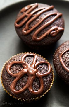 Super Easy, Super Moist Chocolate Cupcakes ~ Easy to make, unusually moist chocolate cupcakes and no mixer required! No eggs either, the recipe uses a combo of baking soda and vinegar for leavening. ~ SimplyRecipes.com