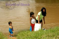Stock Photo titled: Native Waorani Woman With Children Doing Laundry ...