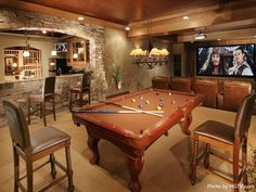 Use a neutral color palette in your man cave. Have the furniture, as well as your massive pool table be a nice contrast to the beige walls. #mancave #colorscheme