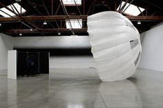 parachute, wind machine, sound proof paneling, installation dimensions variable, © 2011 Carsten Nicolai /Artists Rights Society (ARS), New York / VG Bild-Kunst, Bonn / Photo by: Arturas Valiauga
