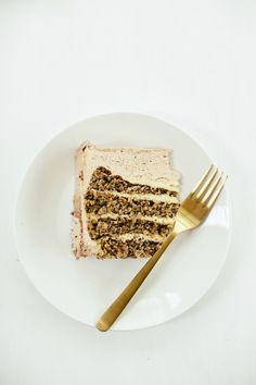 Hazelnut cake with crème mousseline [2 1/2 cups (290g) hazelnuts, skin on, ap flour, canola oil, eggs, etc. Crème Mousseline (German Buttercream): good semisweet or bittersweet chocolate, butter, egg yolk, vanilla extract, confectioners' sugar]
