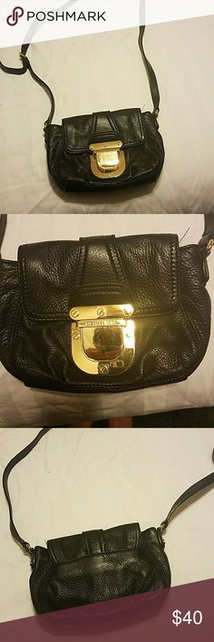 "Michael kors small leather crossbody bag Due to someones ""accidental purchase"" I have to re list this:/ Cute buckle style closure leather bag.  2 pockets inside and a pocket on the back. The buckle closure has some scratches on it.  No rips or tears.   Measurements are approximately 7x6 strap drop is 24 inches. MICHAEL Michael Kors Bags Crossbody Bags"