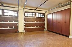 Custom garage doors, garage cabinets and epoxy floor.