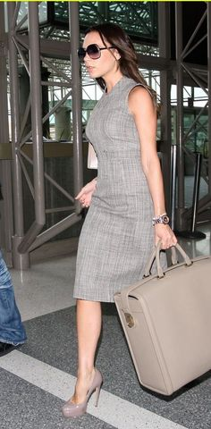 Victoria Beckham...nude pumps with grey sheath dress. Pretty combo!