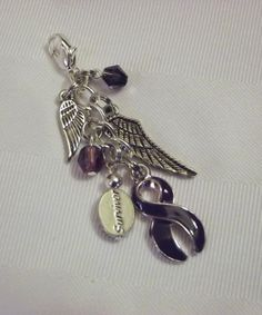 "Purple awareness ""survivor"" purse pull with wings!"