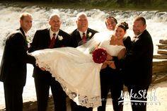 GUYS HOLDING BRIDE