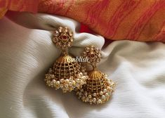 Antique Finish Pearl Bunch Jhumkas From Emblish ~ South India Jewels Pearl Necklace Designs, Jewelry Design Earrings, Gold Earrings Designs, Gold Jewellery Design, Gold Jewelry, Jewelery, Gold Jhumka Earrings, Gold Bridal Earrings, Pearl Jhumkas