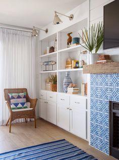 Breezy living room design with white and blue tiled fireplace design | Ponte Vedra Beach Interior Design Service
