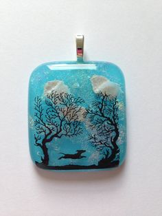 Dog Cremation Pendant where Dog is  Running in a Field of Trees and the Ashes are Seen as Clouds in the Sky by addicted2glassfusion on Etsy