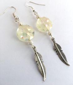 ad0053429 From my Depop shop @karmastrings ... boho sunflower & feather earrings £6.99