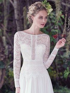 Maggie Sottero - DEIRDRE, Understated elegance is found in this sleeved wedding dress, comprised of lace and Santorini chiffon. Illusion details, a bateau neckline, and a stunning V-back create a sweet-yet-sexy style. Finished with zipper closure.