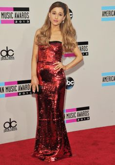 There's no such thing as too many sequins -- just ask Ariana Grande, who wore this shimmering Dolce & Gabbana column gown to the American Music Awards red carpet.