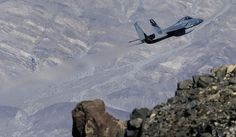 In this Feb. 28, 2017, photo, an F-15C Eagle from the California Air National Guard, 144th Fighter Wing, flies out of the nicknamed Star Wars Canyon over Death Valley National Park, Calif. Military jets roaring over national parks have long drawn complaints from hikers and campers. But in California's Death Valley, the low-flying combat aircraft skillfully zipping between the craggy landscape has become a popular attraction in the 3.3 million acre park in the Mojave Desert, 260 miles east of…