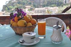 Fresh orange juice and cappuccino