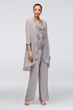 Three-piece ensembles are the stylish-yet-comfortable choice that every mother of the bride or groom loves. Here, silver embroidery embellishes the top and high-low chiffon jacket. By Le Bos Three-p Mother Of The Bride Plus Size, Mother Of The Bride Suits, Mother Of Bride Outfits, Mother Of Groom Dresses, Wedding Trouser Suits, Wedding Pantsuit, Wedding Suits, Pant Suits, Gown With Jacket