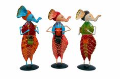 Bring these set of 3 attractive and auspicious Ganesha Musician Idols handmade from Cast Iron to give a vibrant and graceful appeal to your Office Room and Home decoration. This bright set includes 3 musical Ganesha Idols in Colourful Dhoti and Pagdi holding Indian musical instruments. These unusual and unique idols can be placed in your Table tops, in office and home etc. This attractive showpiece combo is ideal for house warming ceremonies and other occasions.