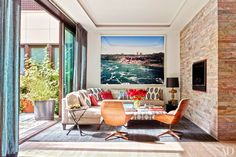 In the Manhattan home of decorator Laura Santos Ankasa pillows accent a custom-made sectional