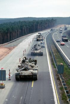American 3rd Armored Division M-60 tanks, operating on German highway during the Cold War