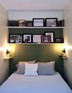LOVE those shelves above the bed with photos! now how would I do this....