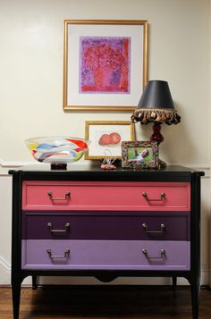 """Traditional hall by Kelly Nelson Designs    {This custom-painted cabinet was inspired by the colors in a Lucette White painting from the couples' art collection. """"We made a very traditional French chest more playful by painting it bright colors,"""" Nelson says.}    Cabinet: Grange"""