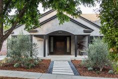 Gray stucco exterior of a 1920s LA bungalow remodeled by Brian Paquette | Remodelista
