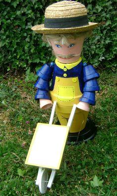 Farmer with his wheelbarrow clay pot creation